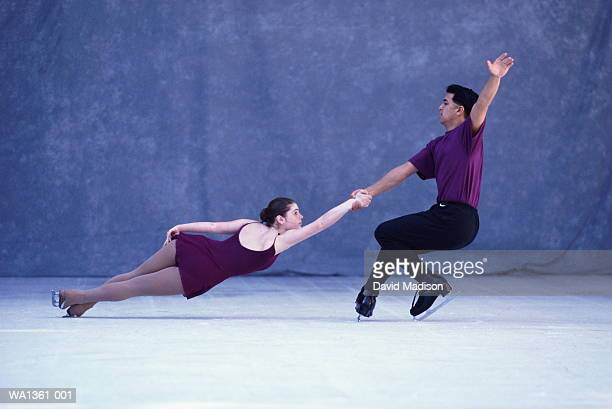 couple figure skating - figure skating stock pictures, royalty-free photos & images