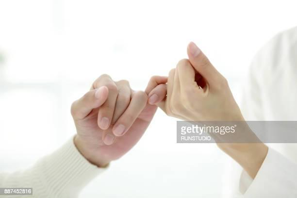 couple fists touching