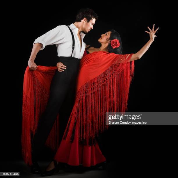 couple flamenco dancing - flamenco dancing stock photos and pictures