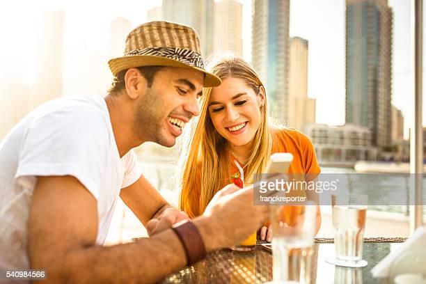couple flirting at cafe in dubai marina drinking oj