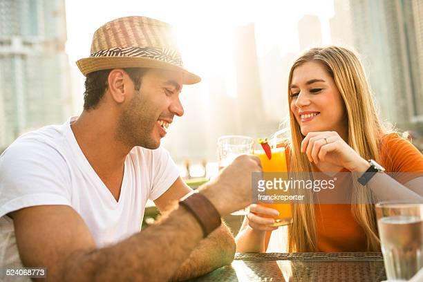 couple flirting at cafe in dubai marina