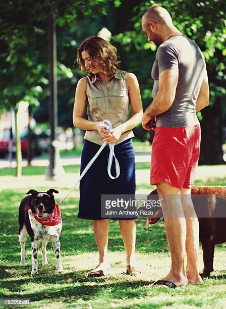 Couple flirting at dog park