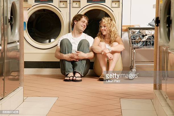 Couple Flirting at Laundromat