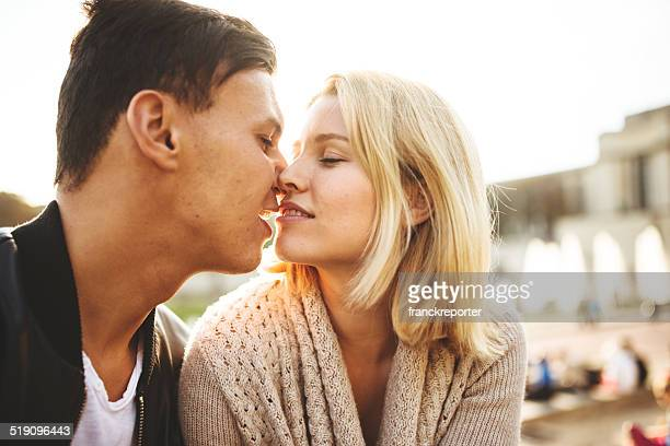 couple flirting at sunlight - interracial wife photos stock photos and pictures