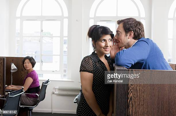 couple flirting in business center - gossip stock pictures, royalty-free photos & images