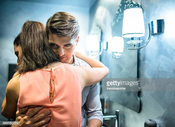 couple flirting in the restroom of a club