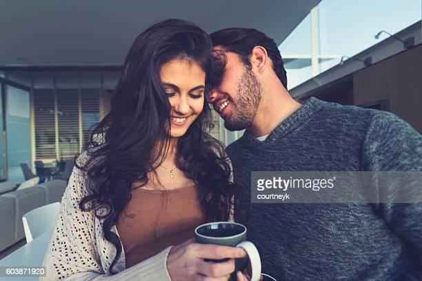 Couple flirting playfully.