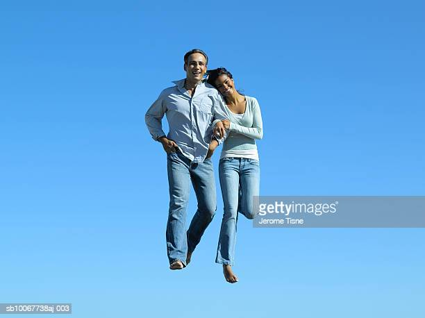 Couple floating in air, portrait