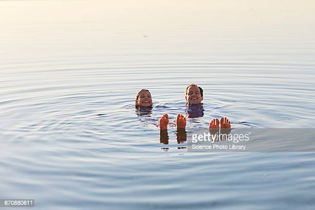 Couple floating in the sea