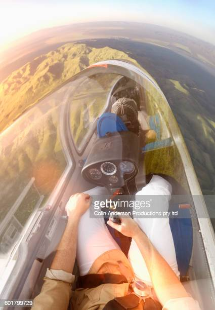 Couple flying glider airplane