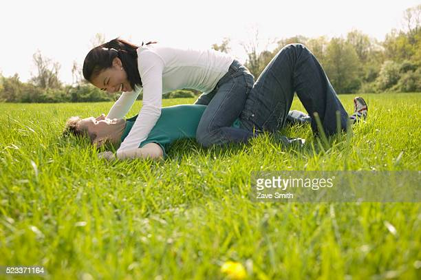 couple fooling around in park - mixed wrestling stock pictures, royalty-free photos & images