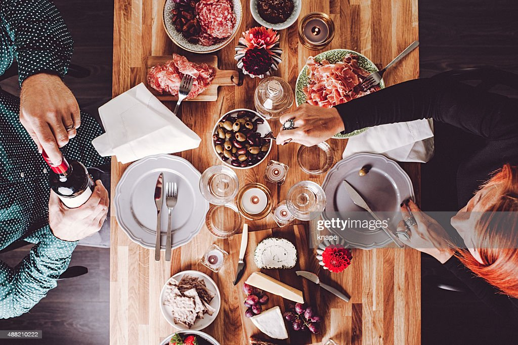 Couple friends having a nice dinner : Stock Photo
