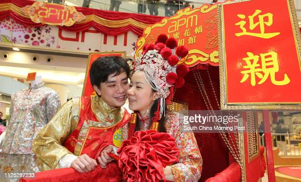 A couple from Mainland Tang Zibin and his wife Tang Kityu dress antique Chinese style dresses in a wedding memorabilia exhibition by APM in Kwun Tong...