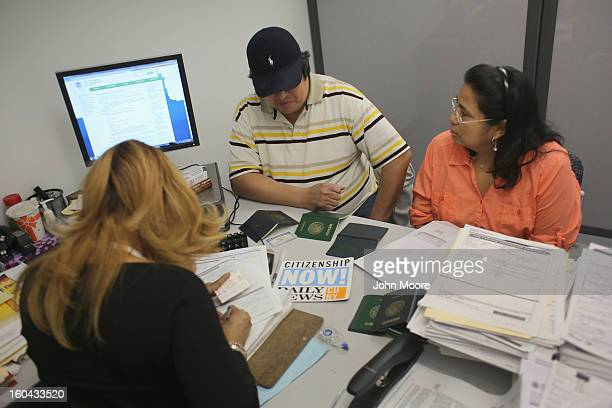 A couple from Mexico receives help with immigration issues on January 31 2013 in New York City They were visiting the CUNY Citizenship Now 'Express...