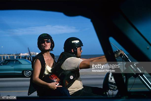 Couple from the Bandidos gang on a motorbike. Texas , September 1969.