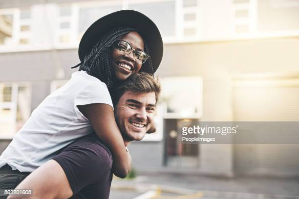 couple fun in the city - multiracial couple stock photos and pictures