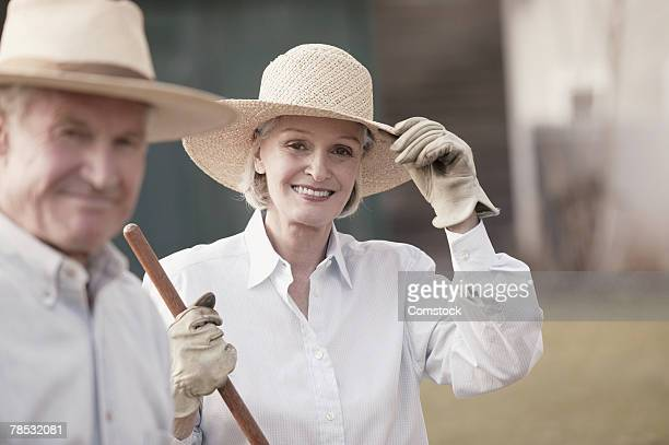 couple gardening - wide brim stock pictures, royalty-free photos & images