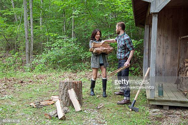 Couple gathering firewood in forest