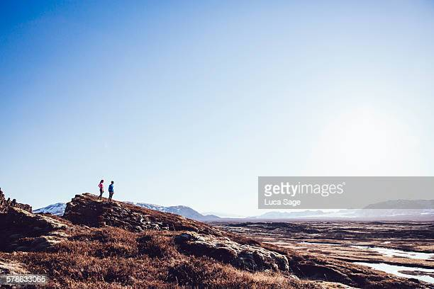 Couple gaze across scenic landscape in Iceland