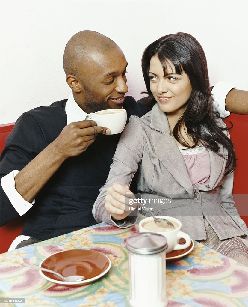 Couple Gazing at Each Other in a Cafe : Stock Photo