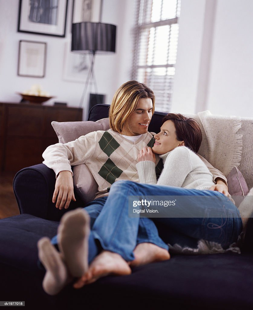 Couple Gazing at Each Other on a Sofa : Stock Photo