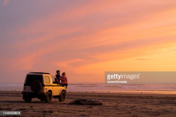 couple get out of car to watch sunrise - 4x4 stock pictures, royalty-free photos & images