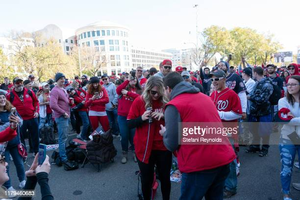 A couple gets engaged as fans gather for the Washington Nationals parade to celebrate their World Series victory over the Houston Astros on November...
