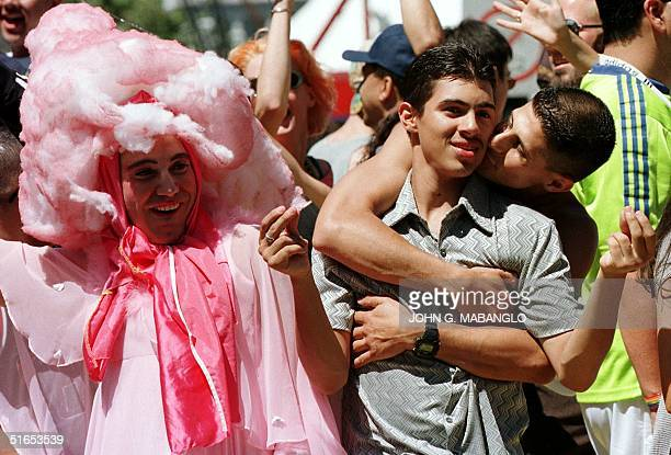 A couple gets intimate on their ride on a float through downtown San Francisco CA during the Gay Pride Parade 29 June Some 40000 people attended the...