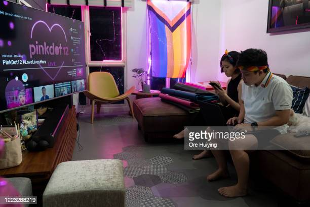 A couple gets ready to start the Pink Dot SG rally livestream in their house on June 27 2020 in Singapore Due to the ongoing coronavirus pandemic...