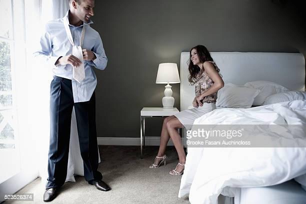 couple getting dressed - verhältnis stock-fotos und bilder