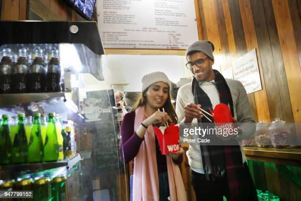 couple getting food from takeaway