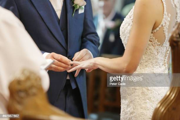 couple getting married in church - wedding ceremony stock photos and pictures