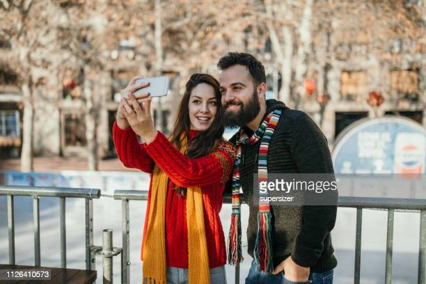 couple getting ready to ice skate - ice rink stock photos and pictures