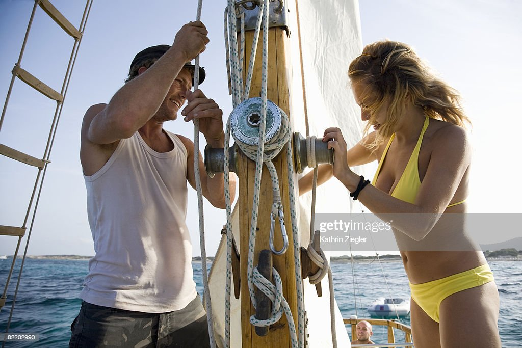 couple getting sailing boat ready : Stock Photo