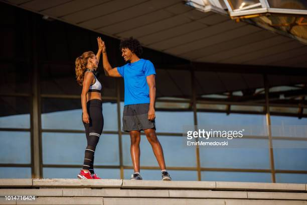 Couple giving each other high five after hard training