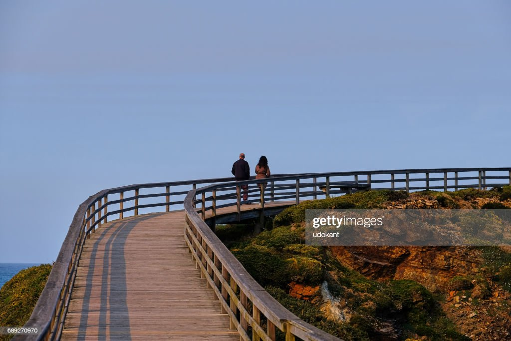 Couple goes for a walk at dusk : Stock Photo