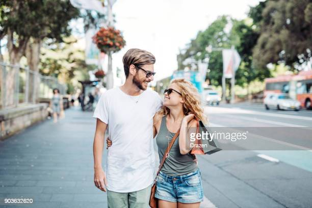 couple goes shopping -  summer sales are here - city break stock pictures, royalty-free photos & images