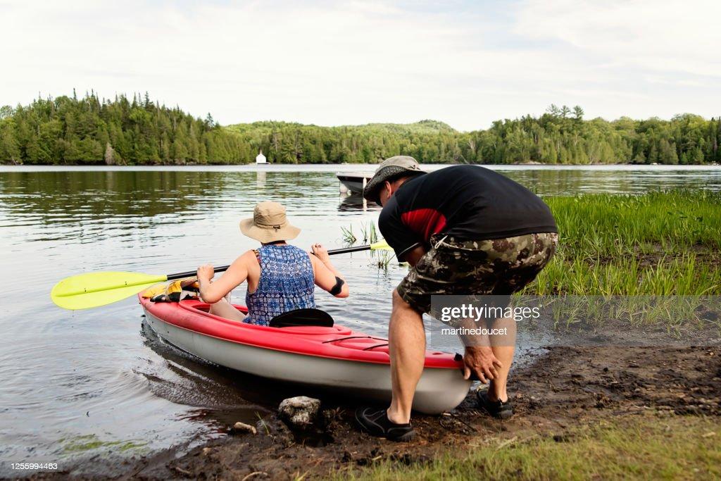 50 + couple going kayaking on a lake. : Stock Photo