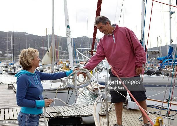 couple going out sailing - moored stock pictures, royalty-free photos & images