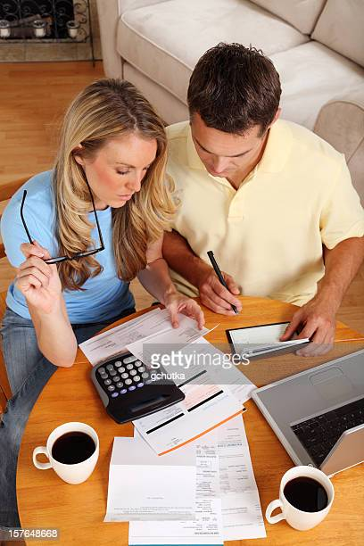 Couple going over their finances with a cup of coffee