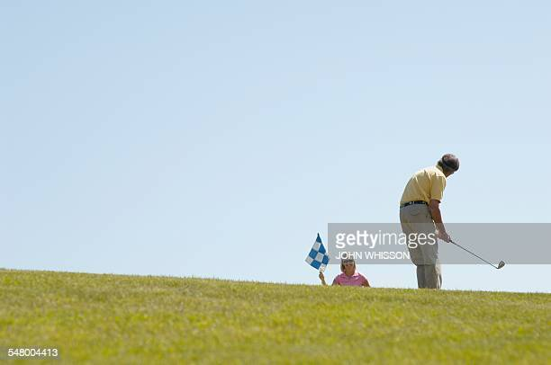 couple golfing - tinted sunglasses stock pictures, royalty-free photos & images