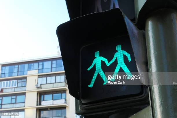 couple green traffic pedestrian light - marriage equality stock pictures, royalty-free photos & images