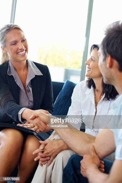 Couple greeting a advisor They are very happy