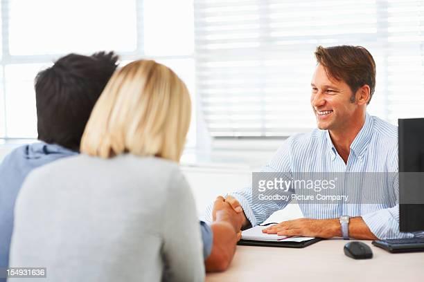 Couple greeting advisor