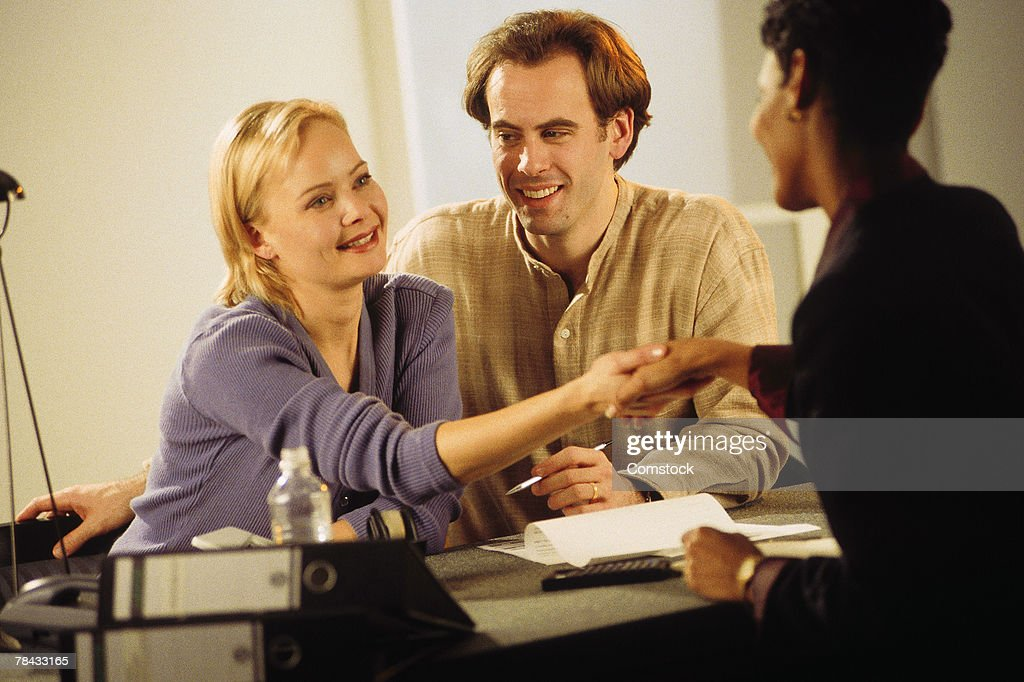 Couple greeting financial planner : Stockfoto