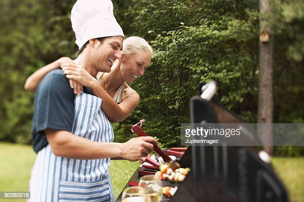 Couple grilling