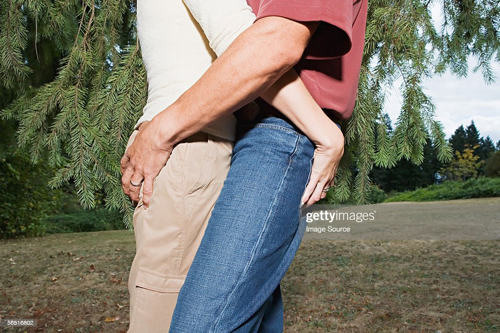 Couple gripping each other's buttocks : Stock Photo