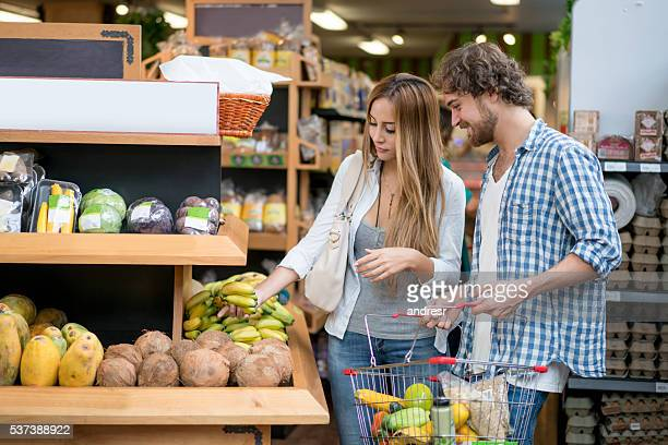 Couple grocery shopping at the food store
