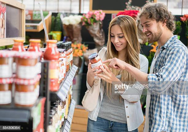 Couple grocery shopping at the supermarket
