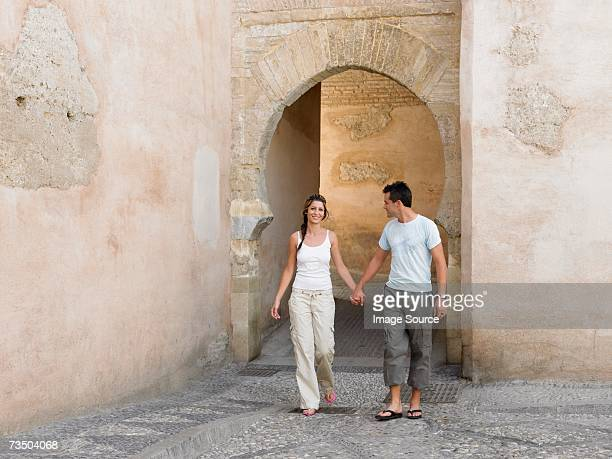 couple hand in hand by arch - granada spain stock pictures, royalty-free photos & images